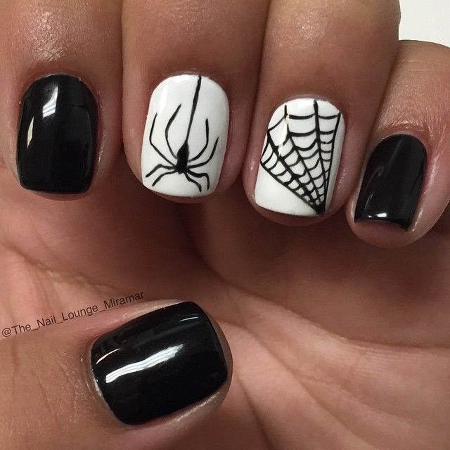 White and black Halloween nails
