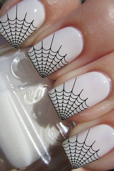 white nails with spider web