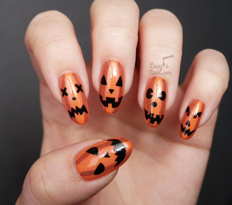 Scary Smiley Halloween Nails with gold and black nail polish