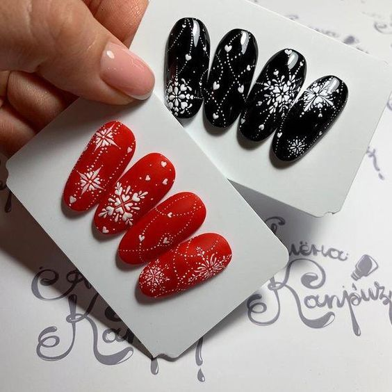 Christmas nails black and red with snow flakes